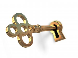 Golden key in keyhole